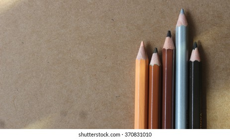 dark tone color pencils on the brown background