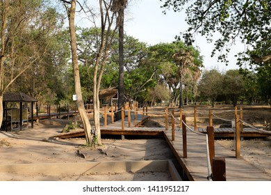 A dark tourist attraction in Phnom Penh, Cambodia - a killing field with wooden walk way to see some pieces of human bones from tragic genocidal history about Khmer Rouge/ Red Khmer