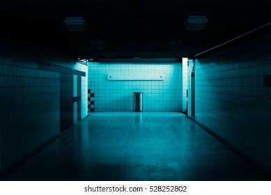 Dark tunnel with a direction sign