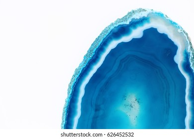 Dark turquoise half  of agate on white background