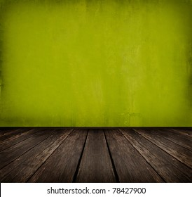 dark vintage green room with wooden floor and artistic shadows added
