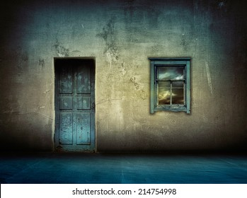 dark vintage interior with blue wooden door and window with sky above at night