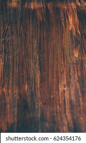 Dark vintage rustic wooden background with selective focus