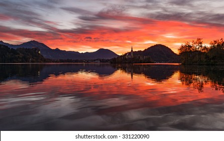 Dark and vivid red sunrise at lake Bled in Slovenia.