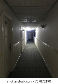 A dark walkway with a small light