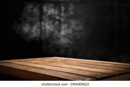 dark wall background. Empty desk workplace in front of abstract package.