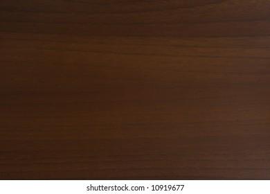 Dark walnut woodgrain texture background