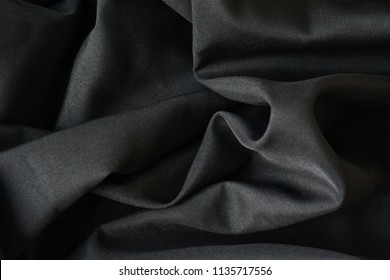 Dark wavy glossy silk drapery,  Rumpled fabric.