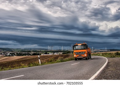 Dark weather and a truck on the road