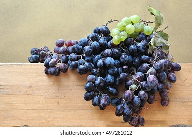 dark and white grapes bunch on wood