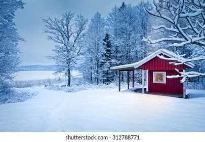 A dark winter evening in a warm and cozy cabin