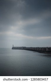 Dark winter time at the jetty in Les Sables d'Olonnse in the French west coast.