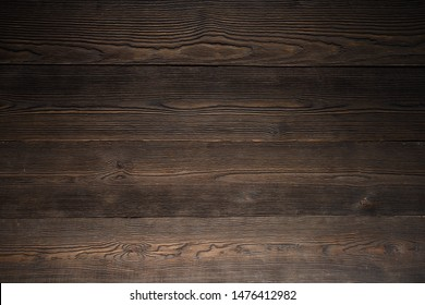 Dark wood background brown color. wall made of wooden planks