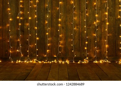 dark wood with christmas lights for background, wall and floor, abstract holiday backdrop