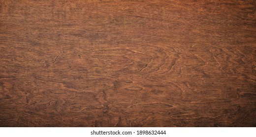 dark wood grain, brown board with a natural pattern. wooden background