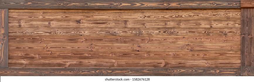 Dark wood texture or background.