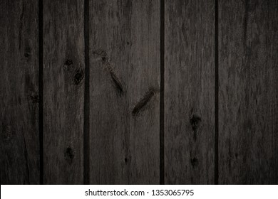 dark wood texture for background. Old wooden boards with knots and scratches.