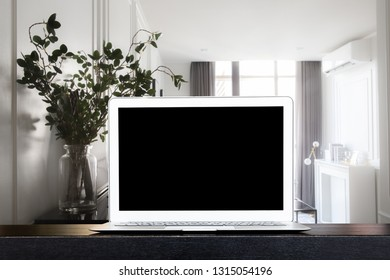 Dark wood working table in black and laptop with copy space. For table background ideas and business concept. - Image