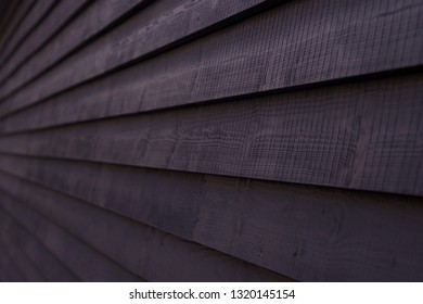 Dark Wooden panelled fence close up