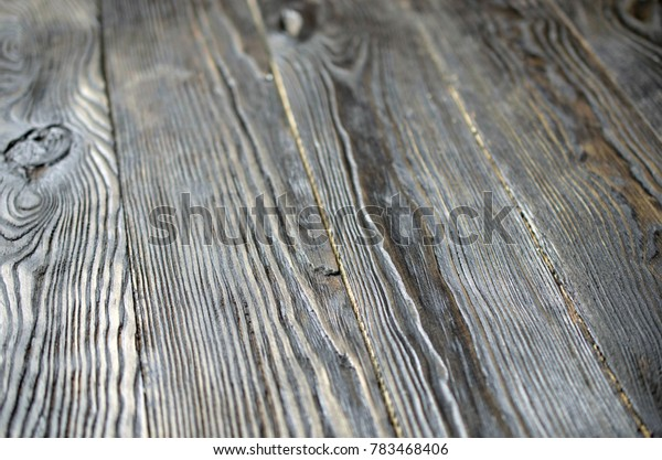 Dark wooden structured background.  Selective focus. Close-up.