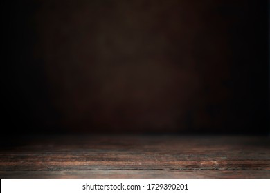 Dark wooden susrface and out of surface background to composite your product into.