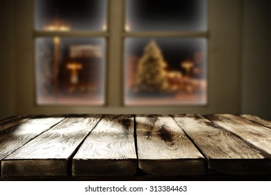 dark wooden table and window space