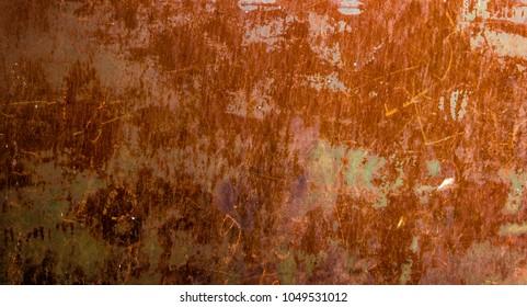 Dark worn rusty metal texture background. Metal texture with scratches and cracks. Rusty metal texture background. Old metal