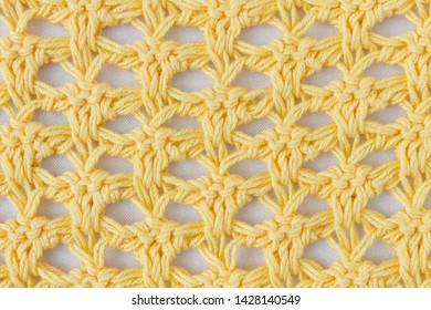 Dark Yellow Knitting Pattern or Knitted Pattern Background in macro style. Knitting Pattern or Knitted Pattern in vintage style for design