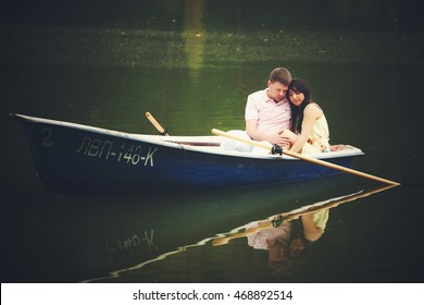 A darkened picture of a couple resting in the boat