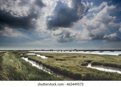 Darkening clouds over a wild Suffolk estuary