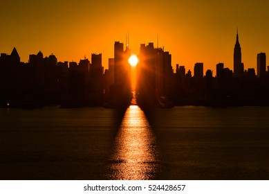 Darker silhouette image of New York sunrise shot on 42nd street