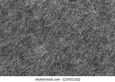 darkgrey felted textile texture of a place mat