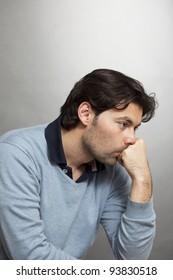 Dark-haired man thinking