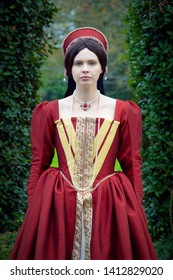 Dark-haired Tudor woman in red dress