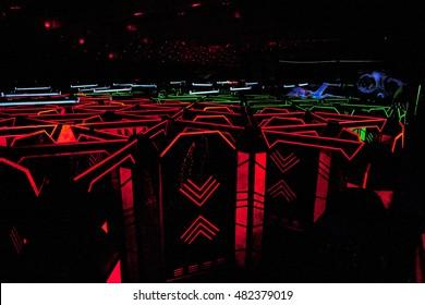 darkness , neon lights, laser tag