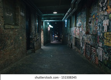 Darkness in a old grunge dirty street in the middle of night