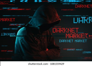 Darknet market concept with faceless hooded male person, low key red and blue lit image and digital glitch effect