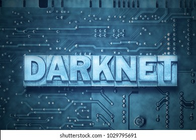 darknet word made from metallic letterpress blocks on the pc board background