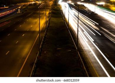 Darknight traffic light trails on street at Thailand.