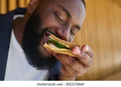 A dark-skinned maneating snadwich with a big appetite