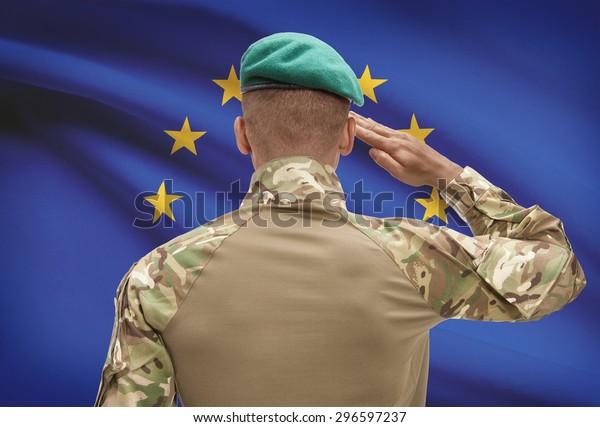 Dark-skinned soldier in hat facing national flag series - European Union - EU