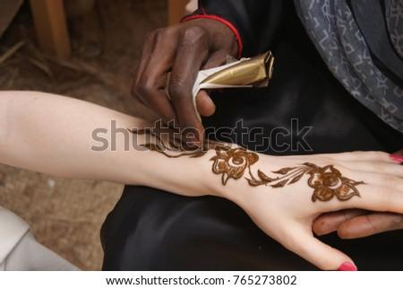 Darkskinned Woman Makes Drawing Henna Tattoo Stock Photo Edit Now