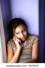darling biracial girl on a cell phone