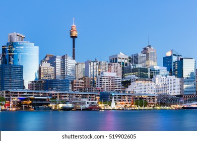 Darling Harbour cityscape and promenade with Christmas tree. Holiday season Sydney cityscape