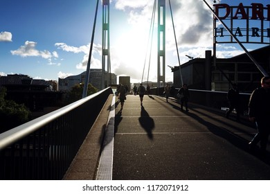 Darling Harbour, Sydney, Australia - September 5 2018: Pedestrians walking across the Pyrmont Bridge in the afternoon