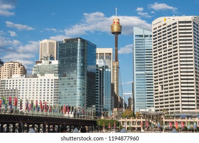 Darling Harbour, Sydney, New South Wales, Australia - Sept 15, 2018: Darling Harbour in Sydney with the city skyscrappers and Sydney Tower in the distance.