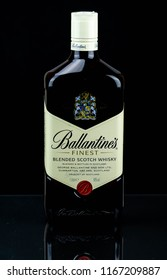 DARLINGTON, ENGLAND - MARCH 29, 2017: Studio shot of a 1 litre bottle of Ballantine's Blended Scotch Whisky on black background.