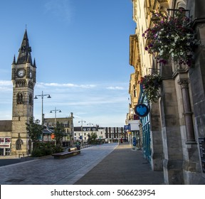 DARLINGTON, ENGLAND - SEPTEMBER 11, 2016: Darlington market clock tower and high street. Banks and shops can be observed along the high street, as well as people going about their business.