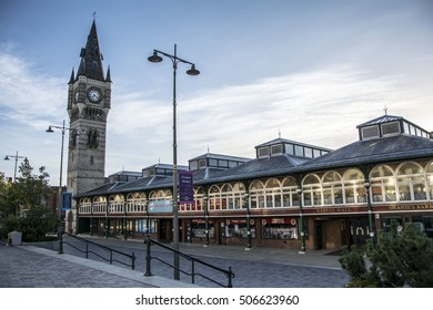 DARLINGTON, ENGLAND - SEPTEMBER 11, 2016: Darlington market hall and clock tower. The market is situated in Darlington town centre. The image was taken on a Sunday morning, before the market opened.