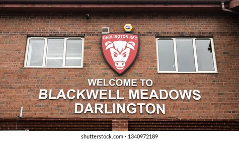 Darlington / Great Britain - March 16, 2019: Sign on the outside wall of the Blackwell Meadows rugby and football ground in Darlington whowing shield logo of Darlington Rugby Footablee Club